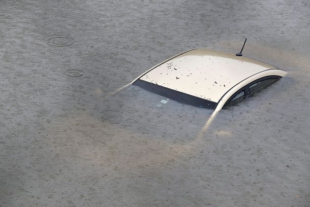 A submerged car is seen on Interstate 610 North on Aug. 27 in Houston as the city battles with tropical...