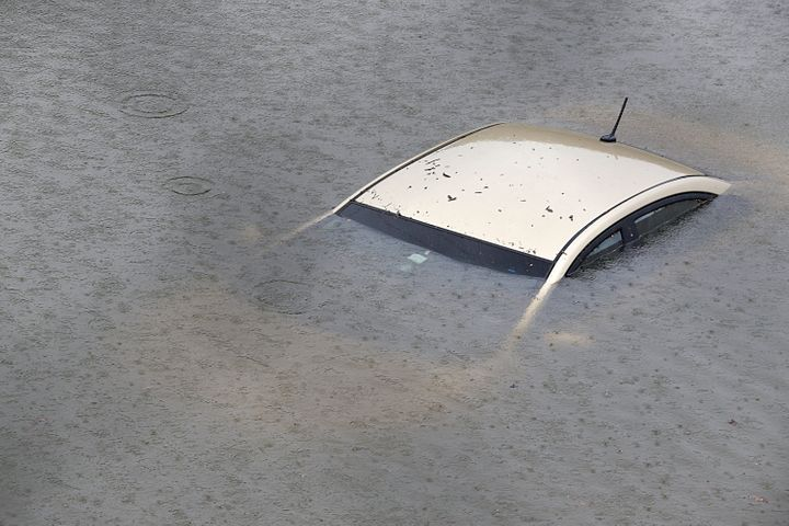 A submerged car is seen on Interstate 610 North on Aug. 27 in Houston as the city battles with tropical storm Harvey and the