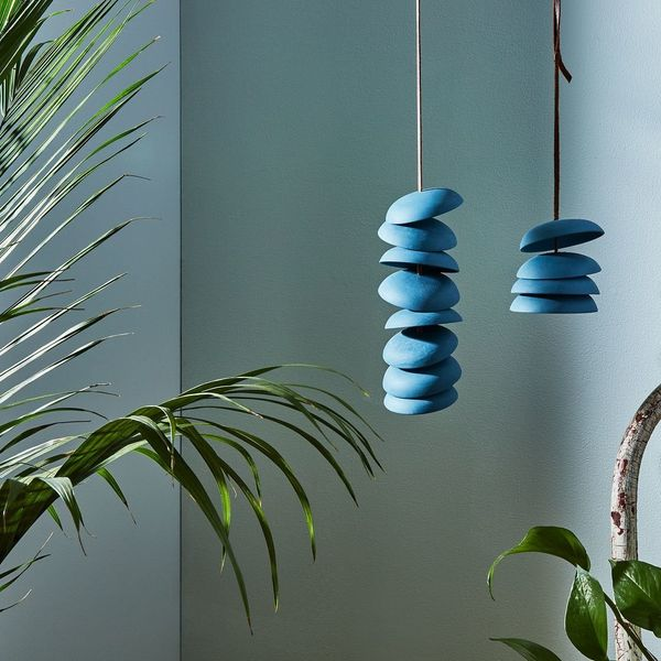 "<a href=""https://food52.com/shop/products/3273-blue-porcelain-wind-chimes"" target=""_blank"">Shop it here</a>."
