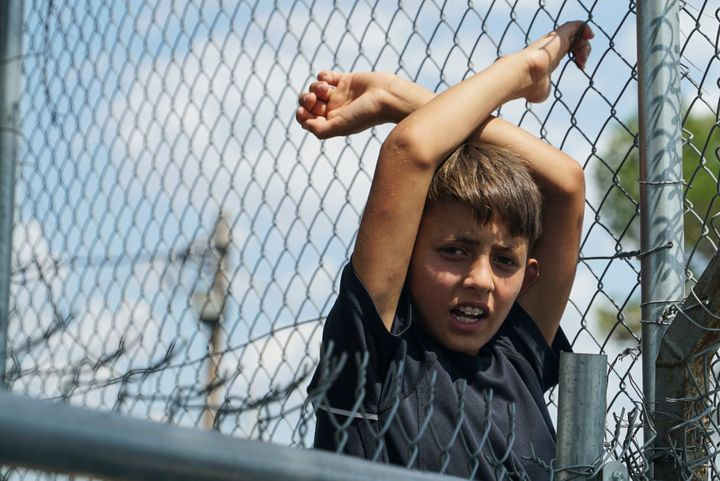 A young refugee boy languishes in the Diavata camp, located in Thessaloniki, Greece, on Aug. 17. More than 50,000 refuge