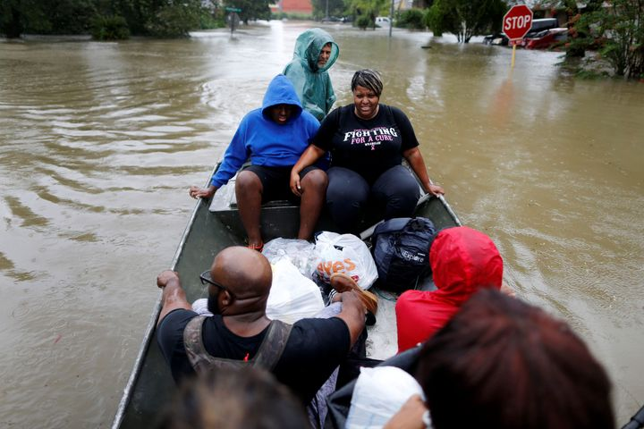 A family is rescued from rising floodwaters in the Beaumont Place community in southeast Texas on Monday.