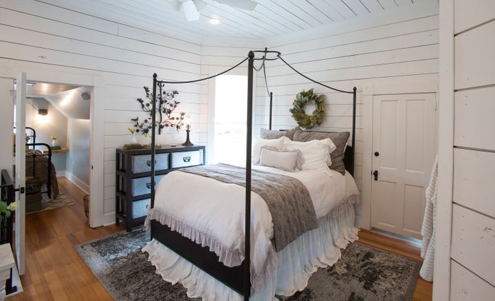 An upstairs landing area made into a bedroom suite.