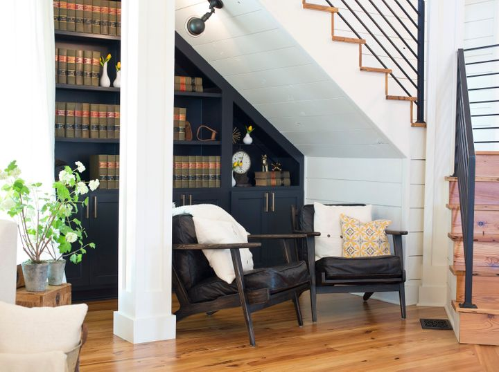 A reading nook beneath the stairs on the first fl