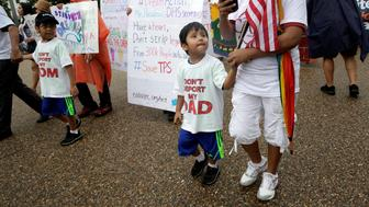 Boys wearing shirts calling for their parents not to be deported march during a rally by immigration activists CASA and United We Dream demanding the Trump administration protect the Deferred Action for Childhood Arrivals (DACA) program and the Temporary Protection Status (TPS) programs, in Washington, U.S., August 15, 2017.   REUTERS/Joshua Roberts