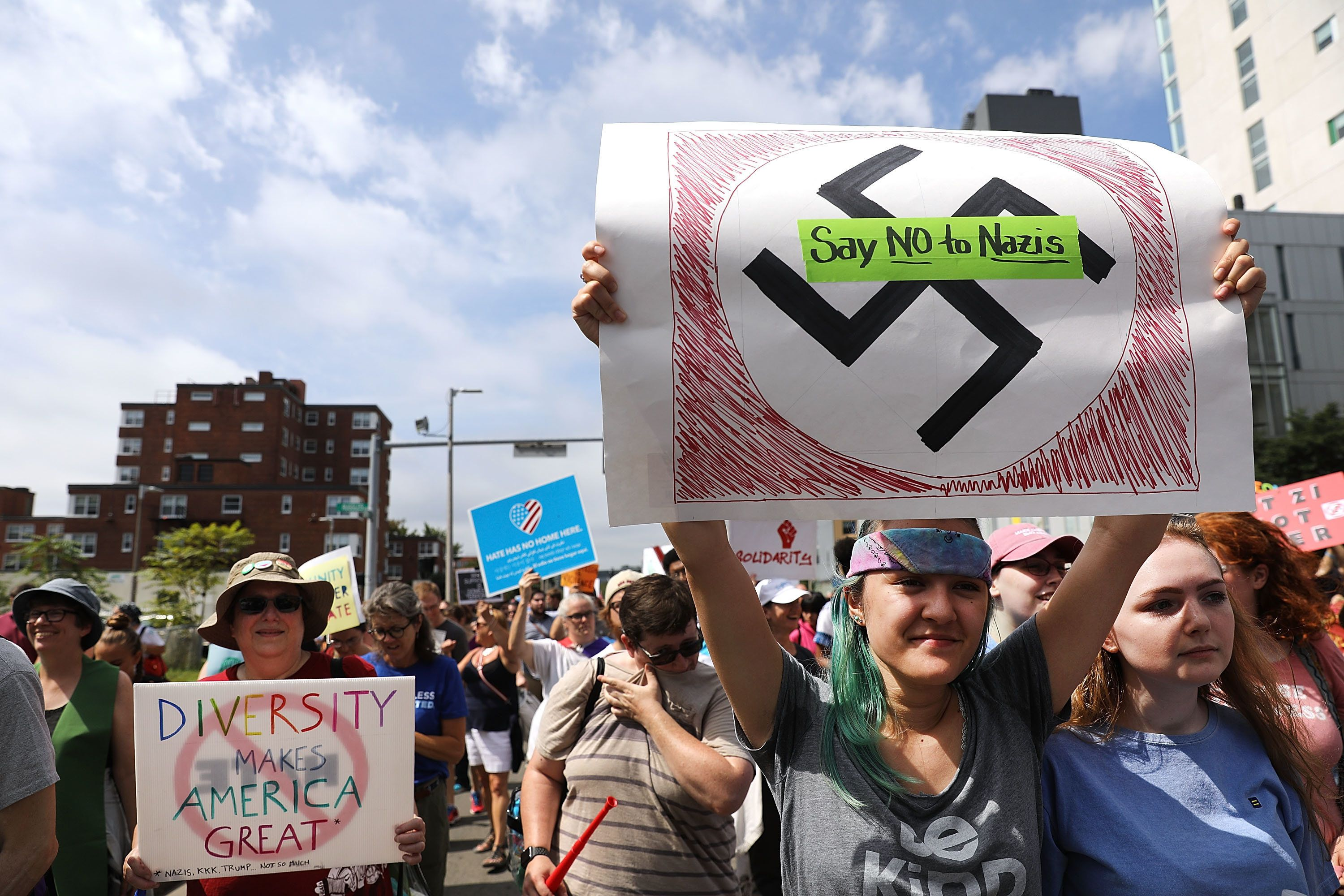 BOSTON, MA - AUGUST 19:  Thousands of protesters march in Boston against a planned 'Free Speech Rally' just one week after the violent 'Unite the Right' rally in Virginia left one woman dead and dozens more injured on August 19, 2017 in Boston, United States. Although the rally organizers stress that they are not associated with any alt-right or white supremacist groups, the city of Boston and Police Commissioner William Evans are preparing for possible confrontations at the afternoon rally.  (Photo by Spencer Platt/Getty Images)
