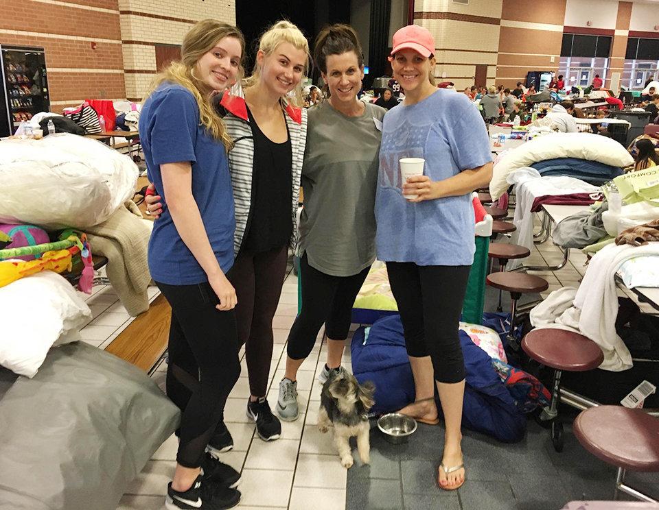Avery Butler, 17, left, Lauren Irving, 17, Whitney Irving, 45, and Jen Guidry, 37, make the best of their timeas evacue