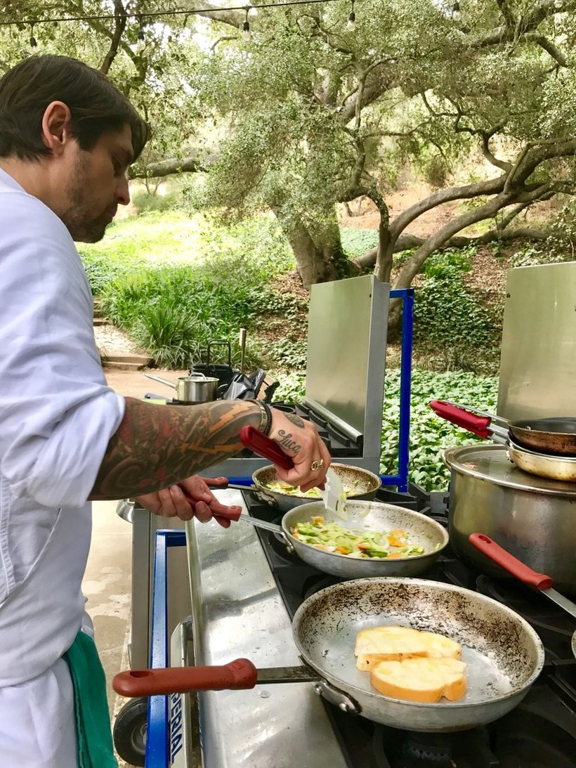 "Chef Ludo Lefebvre cooking outside at the <a rel=""nofollow"" href=""https://goldendoor.com/"" target=""_blank"">Golden Door</a>."