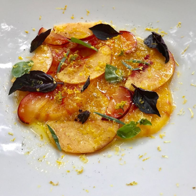 "Peach and tomato salad as prepared by Cacinda Maloney of <a rel=""nofollow"" href=""https://www.pointsandtravel.com/"" target=""_b"