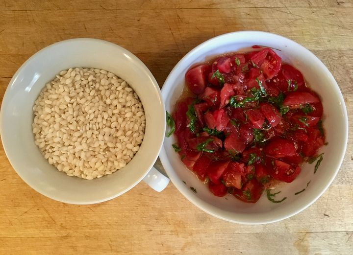 <p>Two thirds cup of rice and a double handful of cherry tomatoes are the principal ingredients</p>