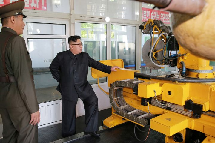 North Korean leader Kim Jong-Un looks on during a visit to the Chemical Material Institute of the Academy of Defense Science