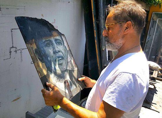 Flavio Alejandro Bisciotti views burned Obama poster