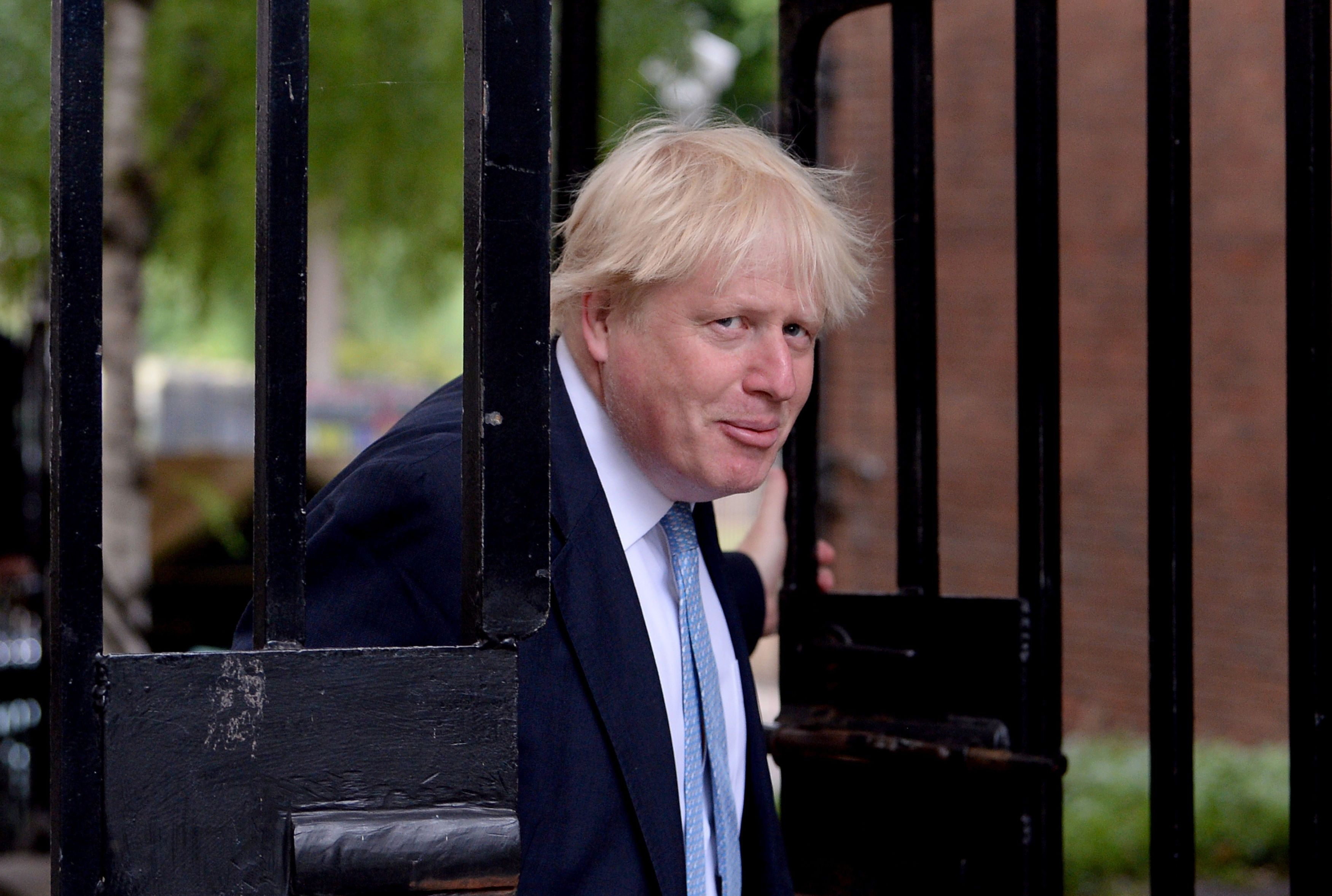 Boris Johnson backed by Theresa May amid domestic and overseas criticism