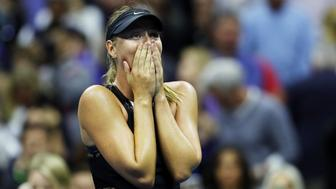 NEW YORK, NY - AUGUST 28:  Maria Sharapova of Russia celebrates winning her first round Women's Singles match against Simona Halep of Romania on Day One of the 2017 US Open at the USTA Billie Jean King National Tennis Center on August 28, 2017 in the Flushing neighborhood of the Queens borough of New York City.  (Photo by Elsa/Getty Images)