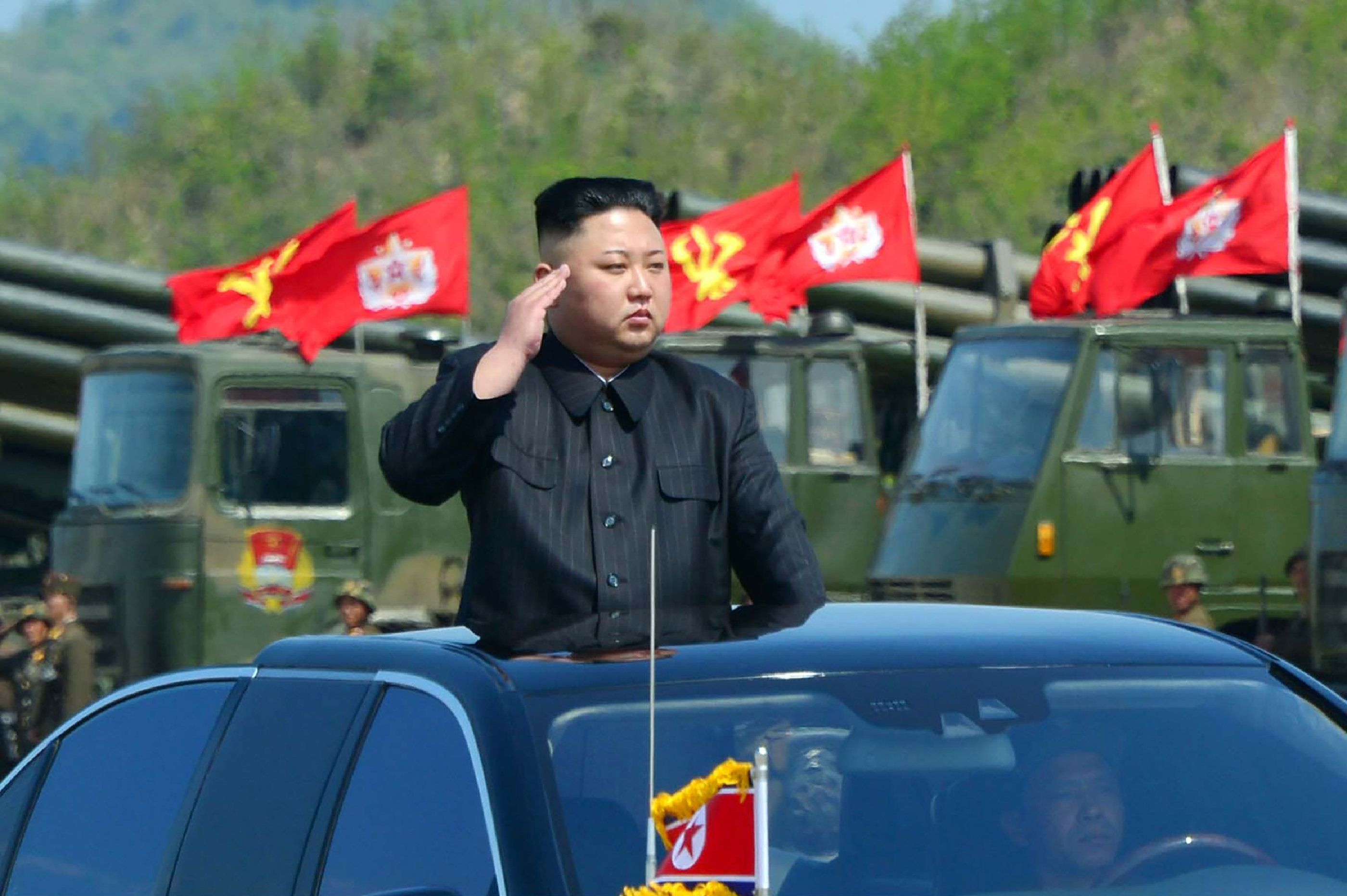 This undated picture released by North Korea's official Korean Central News Agency (KCNA) on April 26, 2017 shows North Korean leader Kim Jong-Un (C) attending the combined fire demonstration of the services of the Korean People's Army in celebration of its 85th founding anniversary at the airport of eastern front. / AFP PHOTO / KCNA VIA KNS / STR / South Korea OUT / REPUBLIC OF KOREA OUT   ---EDITORS NOTE--- RESTRICTED TO EDITORIAL USE - MANDATORY CREDIT 'AFP PHOTO/KCNA VIA KNS' - NO MARKETING NO ADVERTISING CAMPAIGNS - DISTRIBUTED AS A SERVICE TO CLIENTS THIS PICTURE WAS MADE AVAILABLE BY A THIRD PARTY. AFP CAN NOT INDEPENDENTLY VERIFY THE AUTHENTICITY, LOCATION, DATE AND CONTENT OF THIS IMAGE. THIS PHOTO IS DISTRIBUTED EXACTLY AS RECEIVED BY AFP.  /         (Photo credit should read STR/AFP/Getty Images)