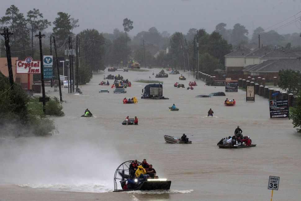 Residents use boats to evacuate in east Houston.