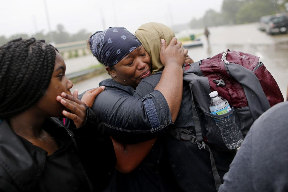 Residents embrace after being rescued from the floodwaters of Tropical Storm Harvey in east Houston, Texas, on Aug. 28, 2017.