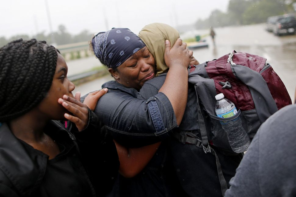 Residents embrace after being rescued from the floodwaters of tropical storm Harvey in east Houston on Aug. 28.