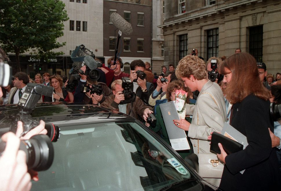 The Princess of Wales being mobbed by photographers and well-wishers as she leaves the Royal College of Nursing in London's C