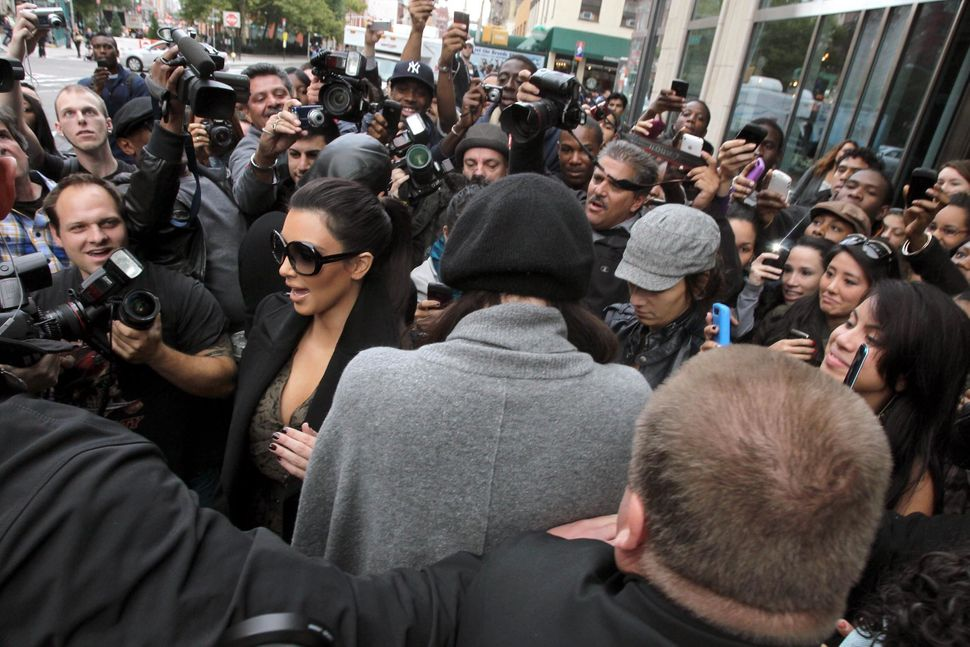 Kim Kardashian leaving her hotel causing a chaotic crowd of fans and paparazzi in 2010.