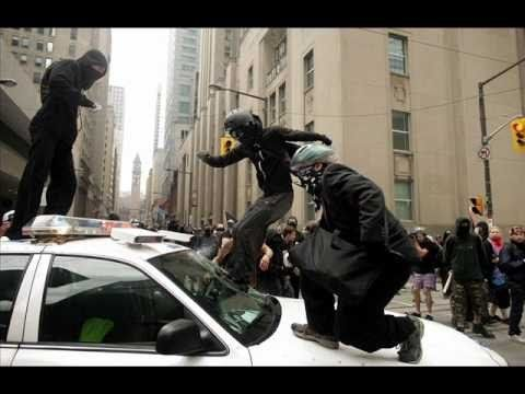 """""""Black bloc"""" members in action a few years ago during the Occupy movement. Precisely what President Donald Trump wants."""