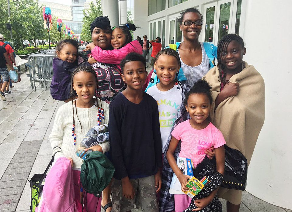 Nina Robinson, top right, lost her home and brought six kids to the shelter at George R. Brown Convention Center in Houston.