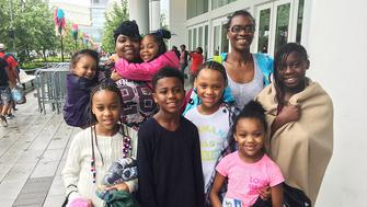 Nina Robinson top right lost her home and brought six kids to the shelter at George R Brown Convention Center in Houston