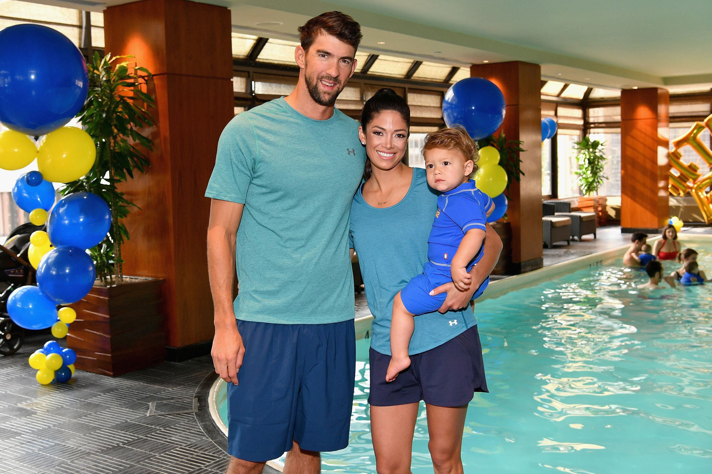NEW YORK, NY - AUGUST 21:  Michael Phelps, Nicole Phelps and Boomer Phelps attend the Huggies Little Swimmers #trainingfor2032 Swim Class With The Phelps Foundation on August 21, 2017 in New York City.  (Photo by Dia Dipasupil/Getty Images for Huggies)