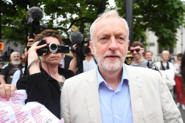 Labour leader Jeremy Corbyn arrives address an anti-austerity rally in