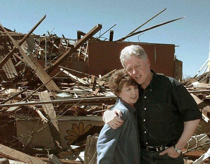 Bill Clinton surveying damage froma series of 2004 tornados in Arkadelphia, Arkansas.
