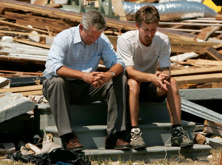 George Bush sitting with Biloxi resident Patrick Wright, whose home was destroyed during Hurricane Katrina in 2005.