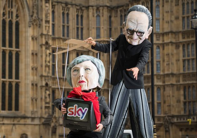 Campaigners from Avaaz dressed as Prime Minister Theresa May and Rupert Murdoch take part in a demonstration...