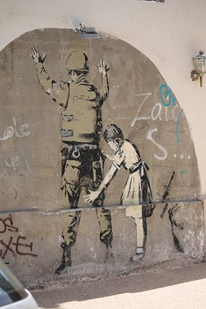 West Bank, Girl and Soldier by Banksy