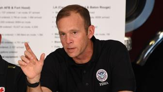 Administrator Brock Long of FEMA speaks during a firehouse briefing on Hurricane Harvey in Corpus Christi, Texas on August 29, 2017. President Donald Trump flew into storm-ravaged Texas Tuesday in a show of solidarity and leadership in the face of the deadly devastation wrought by Harvey -- as the battered US Gulf Coast braces for even more torrential rain.   / AFP PHOTO / JIM WATSON        (Photo credit should read JIM WATSON/AFP/Getty Images)