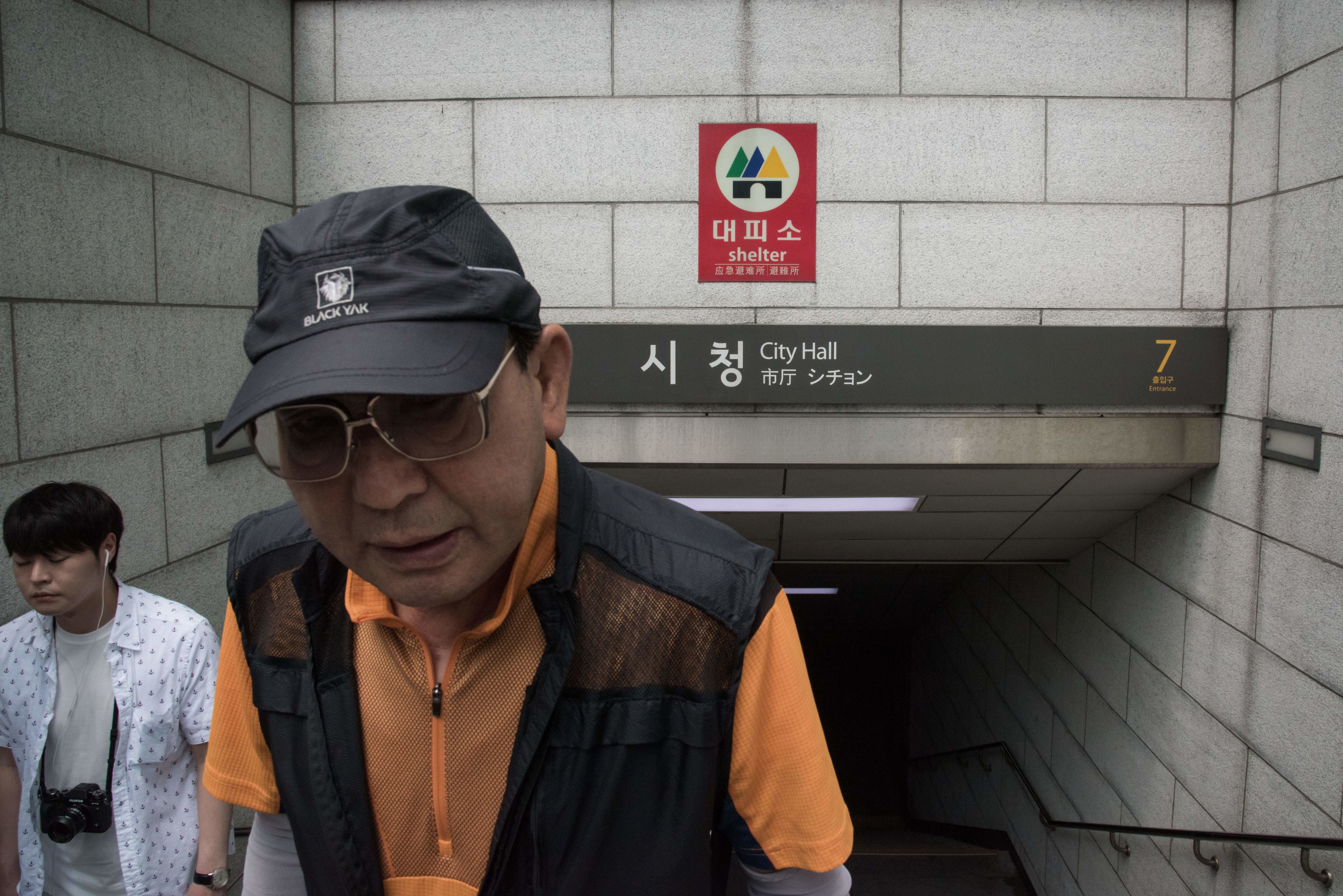 """A """"shelter"""" sign hangs at the entrance to a subway station in Seoul on July 5."""