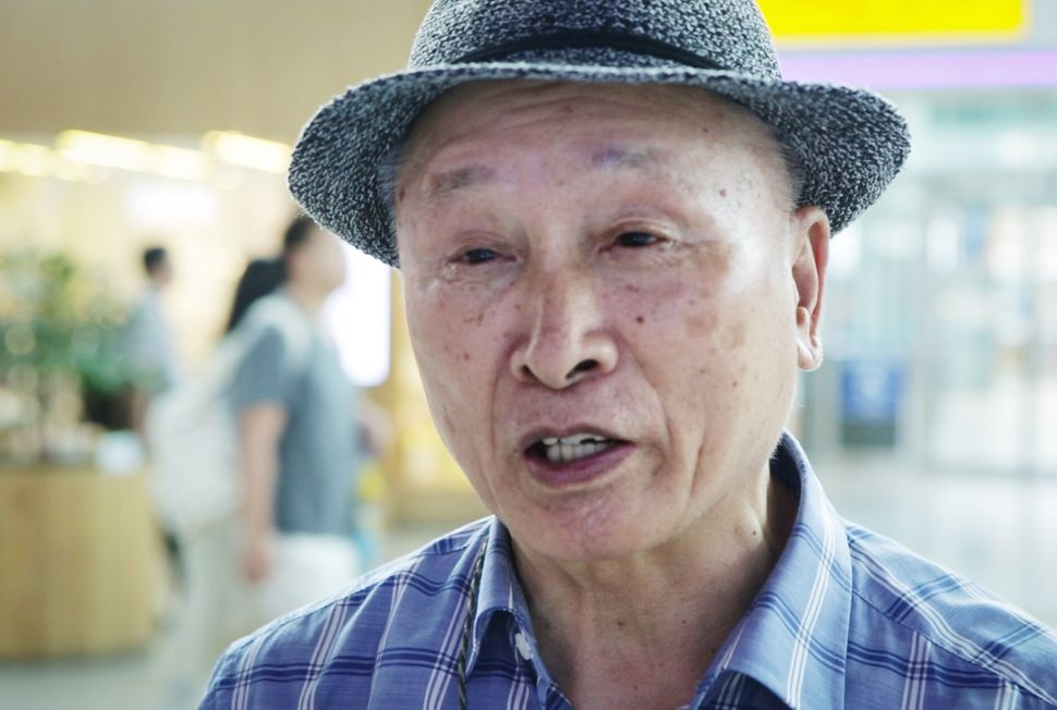 Eighty-four year-old Oh-Jae Kwon talks to reports at Seoul's major railway station.