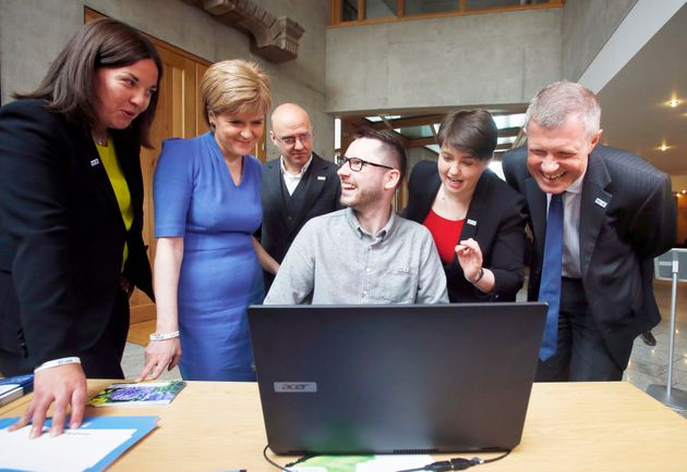 Motor Neurone Disease patient and campaigner Gordon Aikman (centre) meets politicians (left to right)...