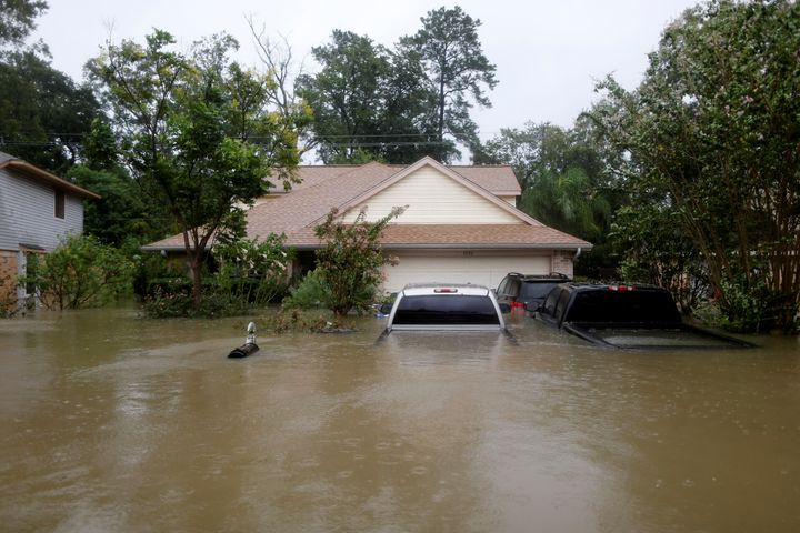 Houses and cars are seen partially submerged by flood waters in east Houston on Monday.
