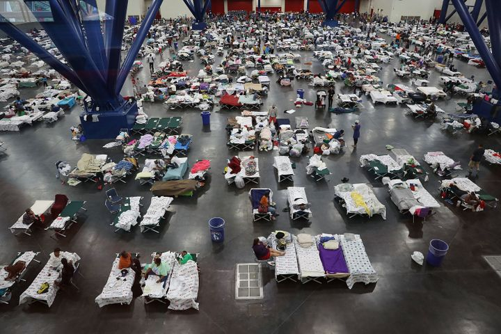 People take shelter at the George R. Brown Convention Center in Houston.