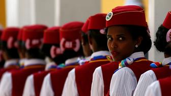 Stewardesses stand in line during the inauguration of the new train line linking Addis Ababa to the Red Sea state of Djibouti, in Addis Ababa, Ethiopia, October 5, 2016. REUTERS/Tiksa Negeri