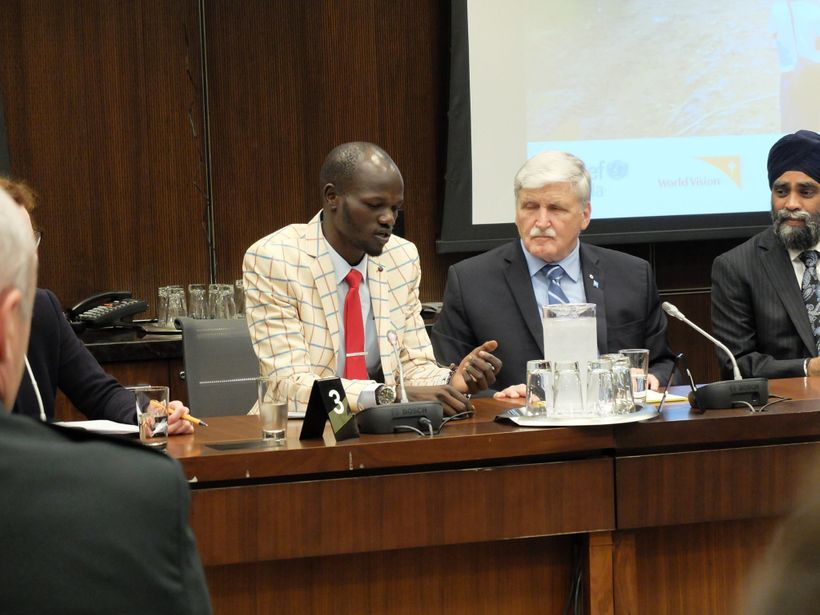 <em>Thuch (far left) with Romeo Dallaire, during the International Day of Peacekeepers</em>