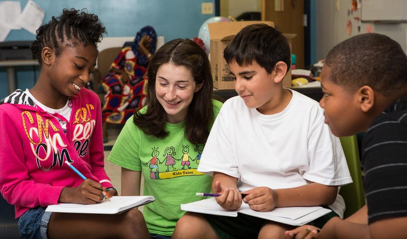 <em>Katie, working with youth at Kids Tales</em>