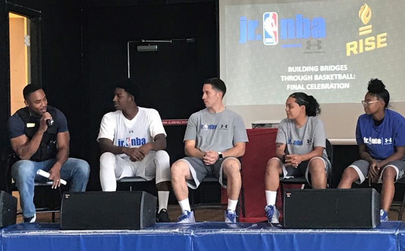 Student-athletes, basketball coaches and a Chicago police officer participate in a panel discussion Thursday, Aug. 24, about