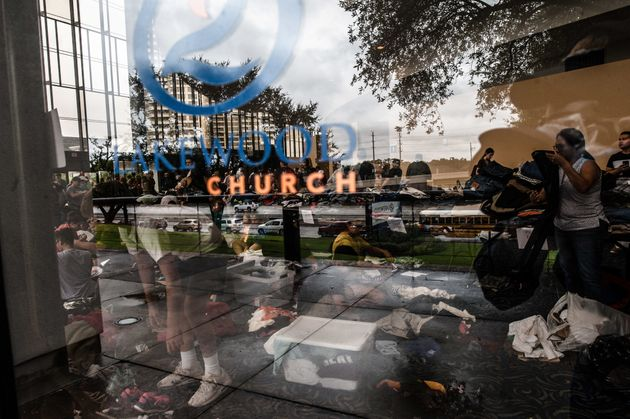 Volunteers take donations at the Lakewood Church in