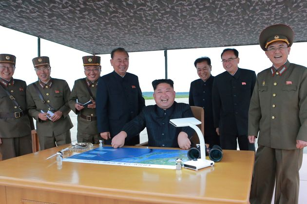 North Korean leader Kim Jong Un inspects a long and medium-range ballistic rocket launch drill in this...