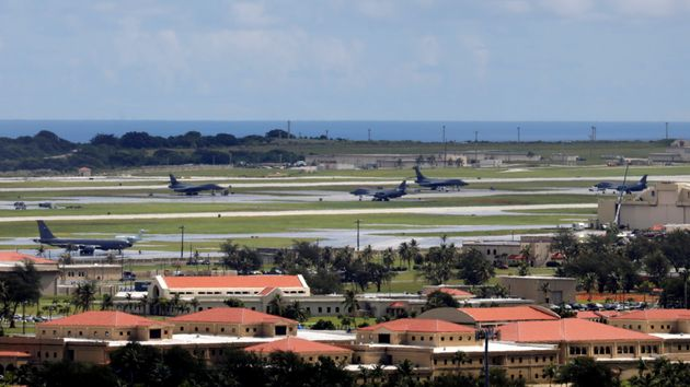 A view of US military planes parked on the tarmac of Andersen Air Force base on the island of