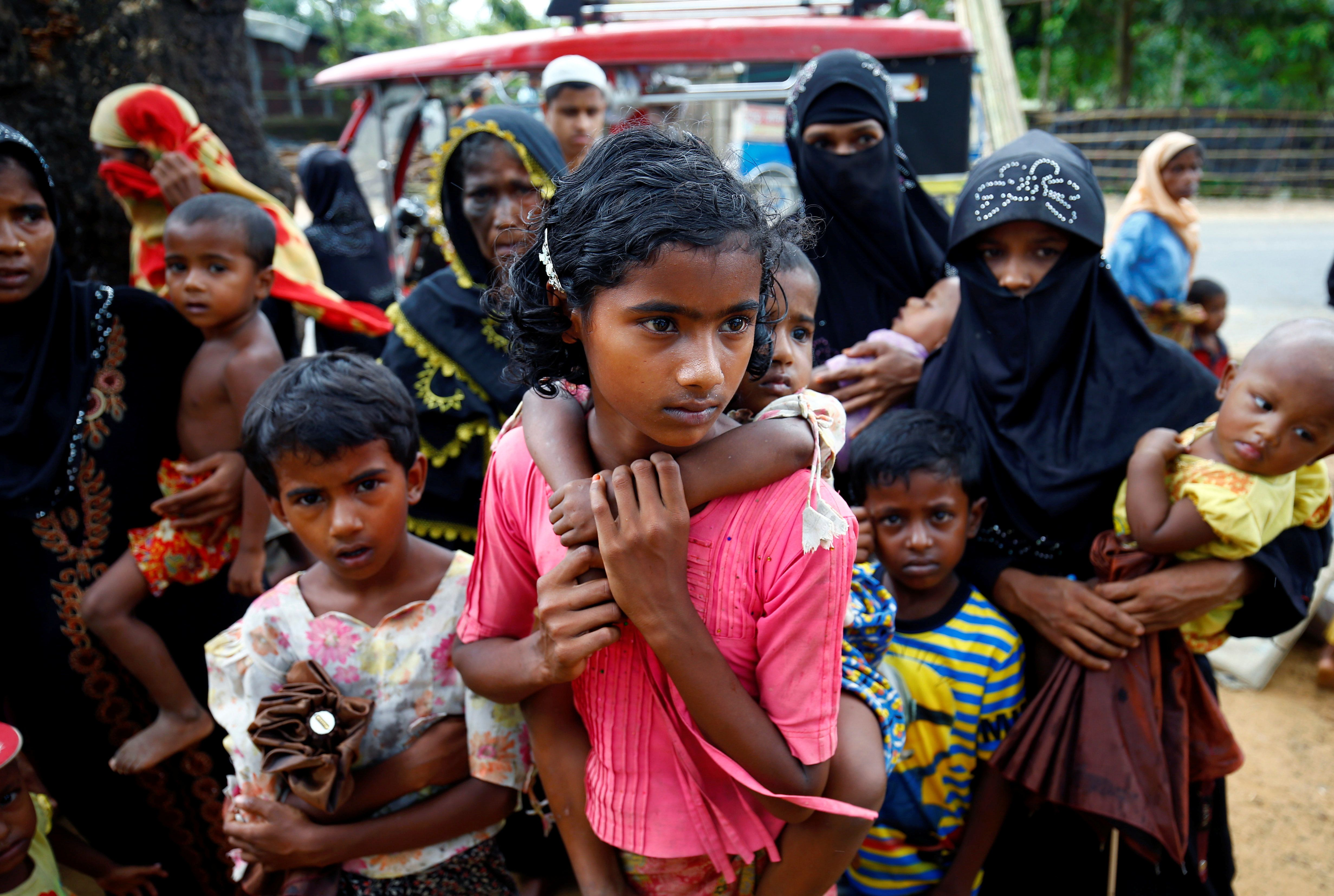 Rohingya refugees arrive near the Kutupalang makeshift Refugee Camp, in Cox's Bazar, Bangladesh on Tuesday.