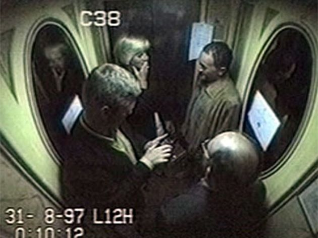 Diana suppresses a giggle in the lift at the Ritz, where she was pictured with Fayed, Rees-Jones and