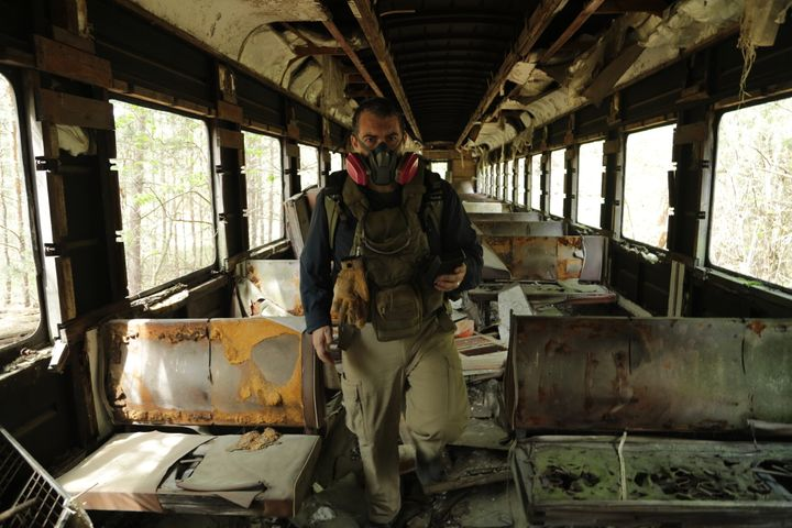 <p>Philip Grossman on an abandoned train at the Chernobyl site.</p>