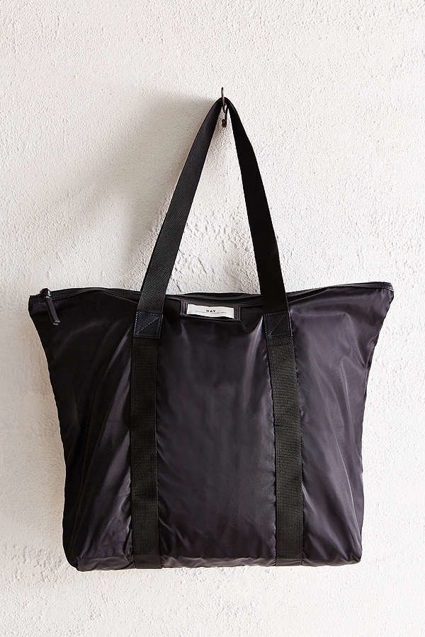 """<a href=""""https://www.urbanoutfitters.com/shop/day-by-birger-et-mikkelsen-gweneth-tote-bag-002?category=bags-wallets-for-women"""