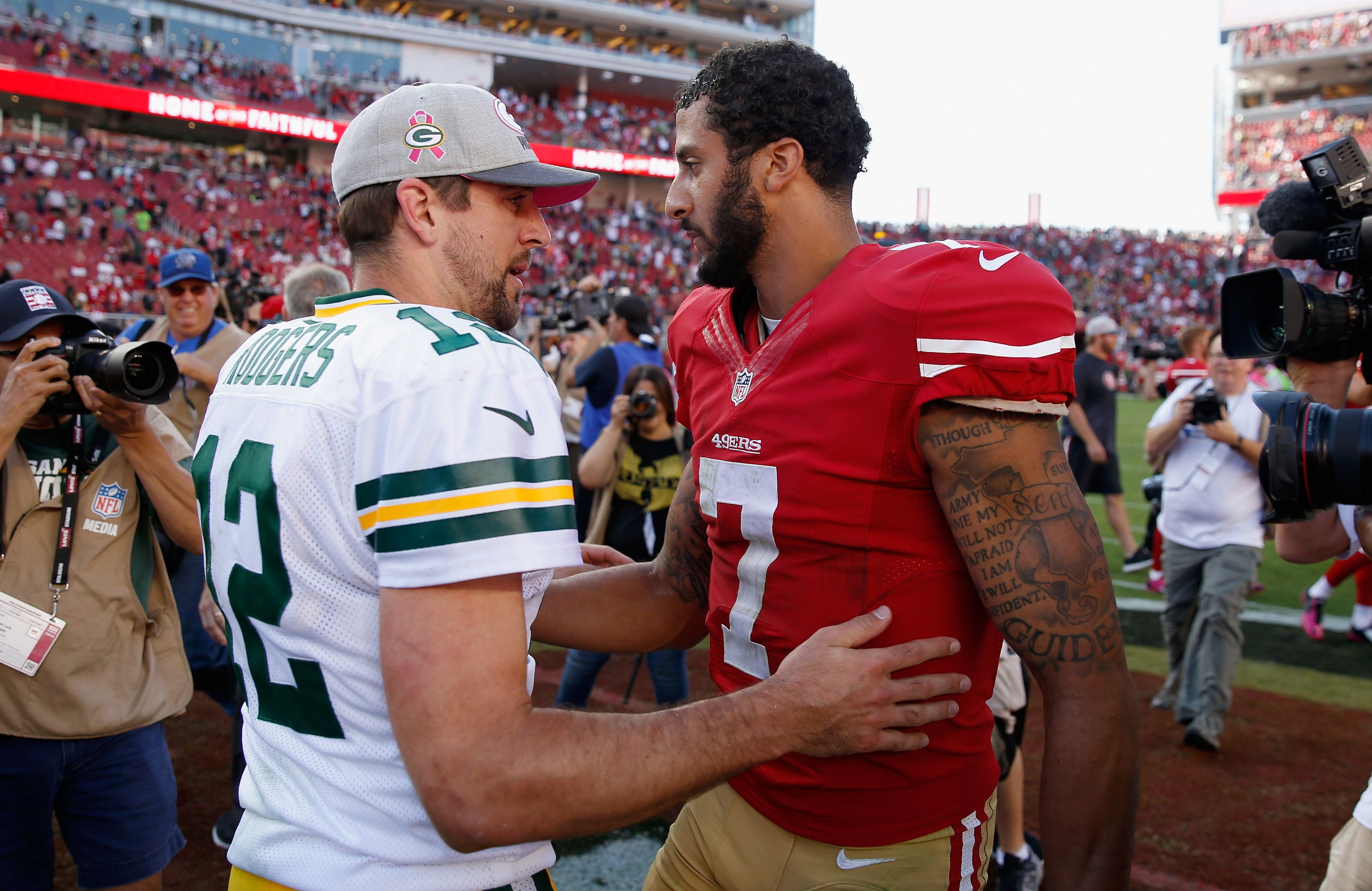 SANTA CLARA, CA - OCTOBER 04:  Colin Kaepernick #7 of the San Francisco 49ers talks with Aaron Rodgers #12 of the Green Bay Packers after their game at Levi's Stadium on October 4, 2015 in Santa Clara, California.  (Photo by Ezra Shaw/Getty Images)